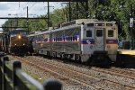 SPAX 337, CSX Q032 catches up to SEPTA making a station stop